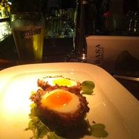 Photo taken at BASA - Basement Bar & Restaurant by Hernan C. on 1/17/2014