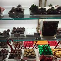 Photo taken at Godiva Chocolatier by Tanya B. on 12/20/2014