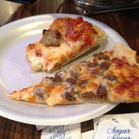 Photo taken at Gusano's Chicago Style Pizzeria & Sports Bar by Polina V. on 1/4/2013