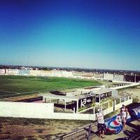 Photo taken at Estádio Municipal Dinarte Mariz by Tatiana A. on 6/1/2013