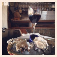 Photo taken at Meritage Martini & Oyster Bar by James Marshall B. on 11/1/2013