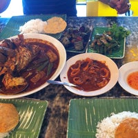 Photo taken at Restoran Kari Kepala Ikan SG by Tengku E. on 5/12/2013