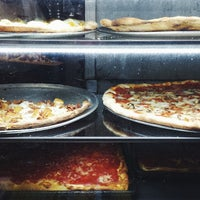 Photo taken at Justino's Pizzeria by Jean S. on 4/27/2014