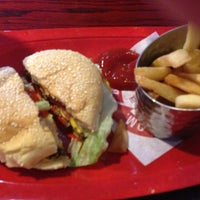 Photo taken at Red Robin Gourmet Burgers by Claire on 8/15/2013