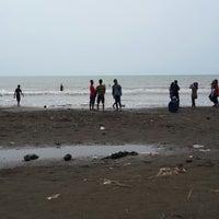 Photo taken at Pantai Purwahamba Indah by Gian C. on 7/31/2014