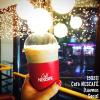 Photo taken at Café NESCAFÉ by Bunny P. on 5/11/2015