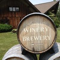 Photo taken at Wagner Vineyards by Sara T. on 6/22/2013