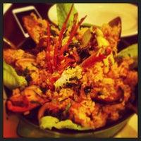 Photo taken at Riko Peruvian Cuisine by Emma S. on 2/6/2013