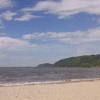 Photo taken at Praia da Penha by Sissi P. on 2/11/2013