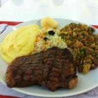 Photo taken at Baby Beef Express by Thiago C. on 3/7/2013