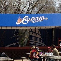 Photo taken at Capital Brewery & Bier Garten by Laure B. on 5/5/2013