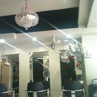 Photo taken at salon de poseur by Kim N. on 1/6/2014