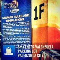 Photo taken at SM Center Valenzuela Parking Lot by MuFFiN M. on 7/29/2013
