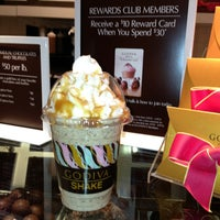 Photo taken at Godiva Chocolatier by Mrs. E. on 3/22/2013