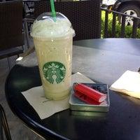Photo taken at Starbucks by Adri S. on 2/18/2013
