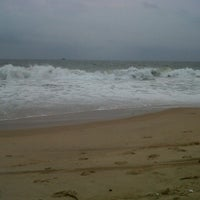 Photo taken at Candolim Beach by Terence R. on 5/25/2014