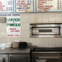 Photo taken at Pizzeria Roccolano by Martha D. on 5/11/2013