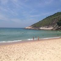 Photo taken at Praia de Grumari by Roberta M. on 2/14/2013