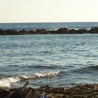 Photo taken at Municipal Beach by Gaya A. on 6/22/2013
