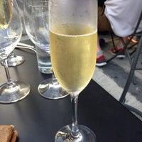 Photo taken at The Tangled Vine Wine Bar & Kitchen by Pamela P. on 9/21/2013