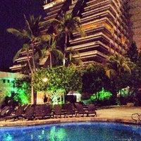 Photo taken at The Fairmont Acapulco Princess by Eduardo J. on 3/28/2013