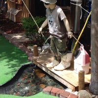 Photo taken at The Fish Hole Mini Golf by Mike M. on 7/20/2016