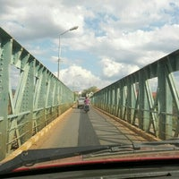 Photo taken at Laos-France Old Sedone Bridge by Aing V. on 2/26/2013