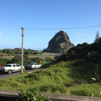 Photo taken at The Piha Cafe by Sarah B. on 7/7/2013