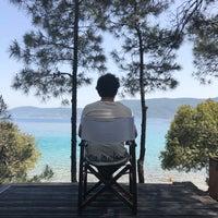 Photo taken at Amanrüya Beach Club by Veli Efe E. on 5/14/2018