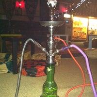 Photo taken at Sphinx Hookah Bar & Cafe by Nicki B. on 10/7/2013