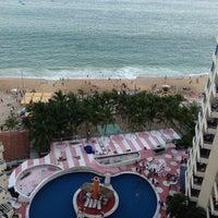 Photo taken at Hotel Playa Suites by Perla G. on 7/13/2013