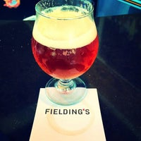 Photo taken at Fielding's local kitchen + bar by Crispin G. on 9/18/2015