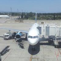Photo taken at Gate 214 by Anastasiya T. on 7/27/2013