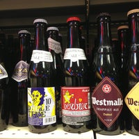 Photo taken at Wegmans Wine Store by Kelly S. on 5/18/2013