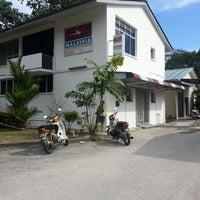 Photo taken at Post Office (Pejabat Pos) by wei w. on 2/4/2014