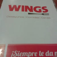 Photo taken at Wings by Rebeca B. on 3/29/2014