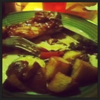 Photo taken at Applebee's Neighborhood Grill & Bar by Alexis M. on 1/13/2013