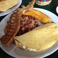 Photo taken at Restaurante Típico Juan José by Paula V. on 9/11/2013