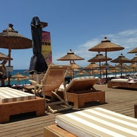 Photo taken at Mango Beach Bar by Alexandros S. on 6/1/2013