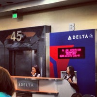 Photo taken at Gate 45 by Andrey S. on 3/14/2013