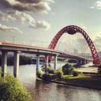 Photo taken at Zhivopisny Bridge by Alex K. on 7/10/2013