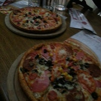 Photo taken at pizza tomato by ilker T. on 3/29/2013