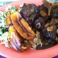 Photo taken at Island Spice Jamaican Restaurant by Kennee M. on 4/3/2013