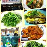 Photo taken at Restoran Kampung by Yasmine L. on 10/4/2014