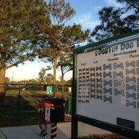 Photo taken at Destin Dog Park by Lu L. on 2/19/2013