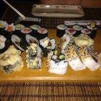 Photo taken at Sushi Garden by Carmen P. on 6/8/2014