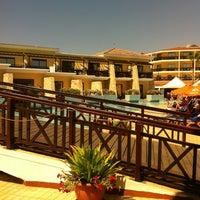 Photo taken at Atlantica Aeneas Resort Hotel pool by Svetlana on 6/19/2013