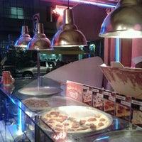 Photo taken at O Pedaço da Pizza by Gus L. on 1/5/2013
