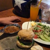 Photo taken at EAT. Bar & Grill by Elena K. on 9/21/2017
