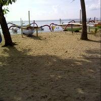 Photo taken at Pantai Segara Ayu by gusti s. on 3/28/2013